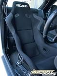 """Штатное водительское сиденье заменили на гоночный """"ковш"""" от Recaro, в салоне установили каркас безопасности от Design Craft Fabrication, а также слегка обновили аудио-систему."""