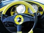 Дэн начал закупать детали еще за год до того, как купил саму машину, и дом его был доверху забит всяким автомобильным добром. Набалдашник и чехол на КПП вместе с комплектом ремней безопасности (все от Momo) могли бы неплохо уместиться в смывном бачке, а гоночные сиденья от NEX и руль от Italvolanti – и вовсе в душевой кабинке.